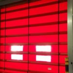 bright red fast industrial door installed by milex