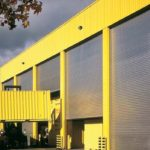 an application shot of roller shutters on a yellow building