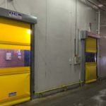 high speed yellow industrial doors installed in a warehouse