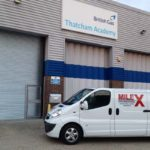 a milex van parked outside a set of roller shutters for british gas
