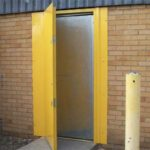 a yellow personnel door installed by milex engineering