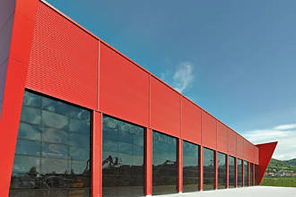 large red distribution warehouse with reflective pvc roller shutters