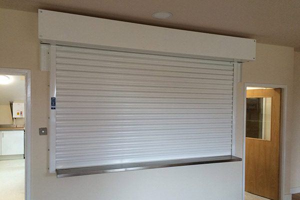 a full view of closed roller shutters installed in a warehouse canteen