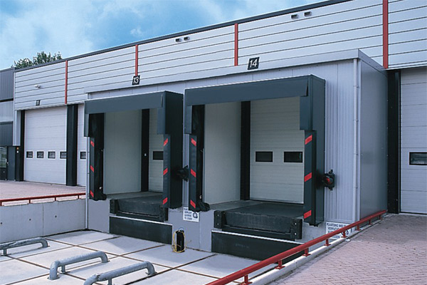 five large roller shutteres installed on 2 lorry loading bays and three traditional loading bays