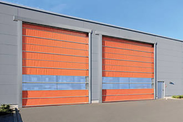 a large scale warehouse featuring two felt orange shutters