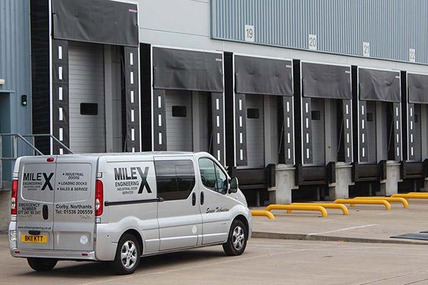 Milex engineering corby van in front of loading bay doors