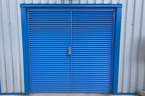 Ventilated fire and secutiry doors fixed to a metal pannel warehouse