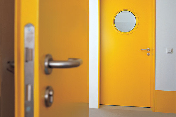 yellow industrial security doors with secure locking system