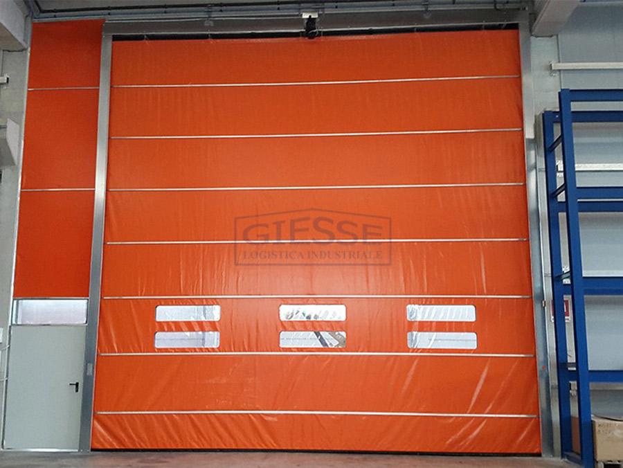 a large Giesse branded, orange fabric roller shutter