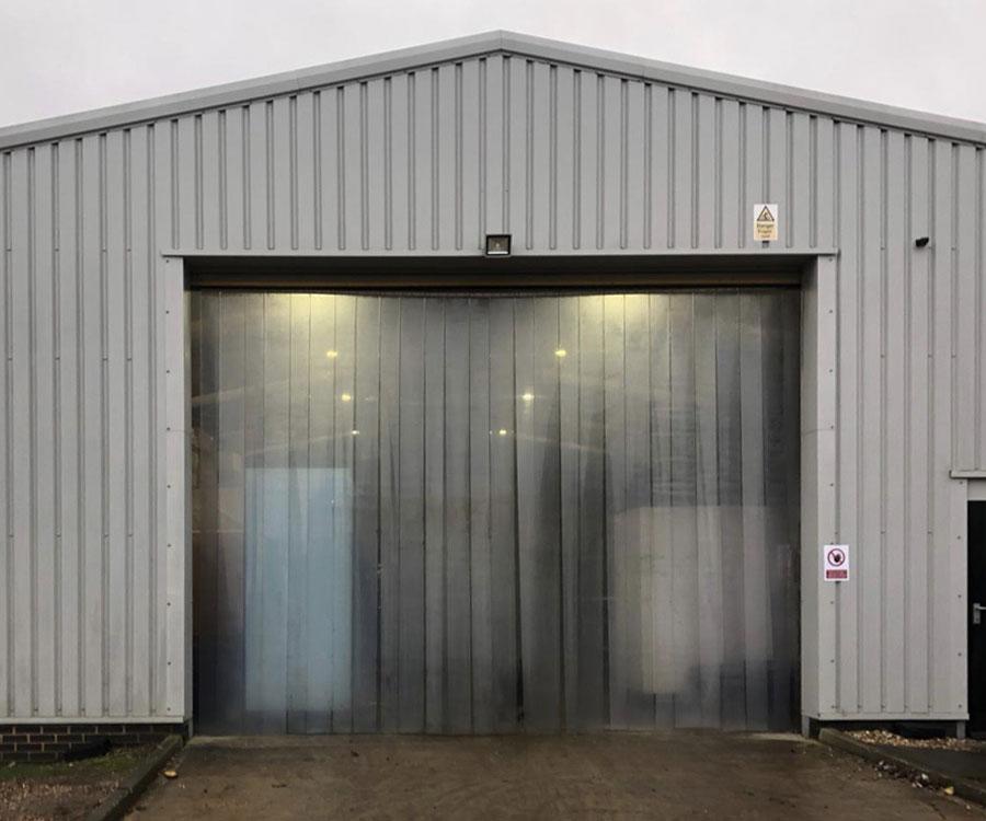 curtain strips installation on an light industrial warehouse