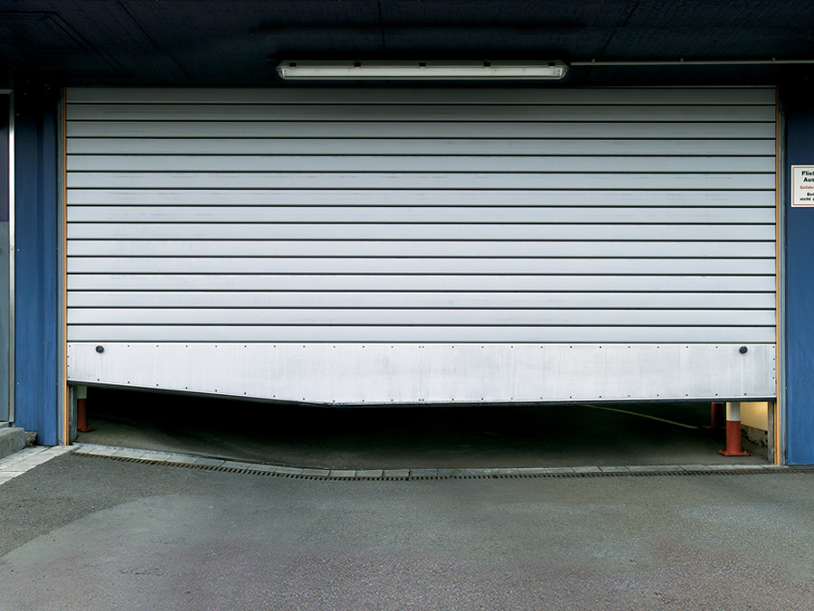roller shutter with a bespoke detailing along the bottom to ensure a complete seal in spite of a raised flooring area